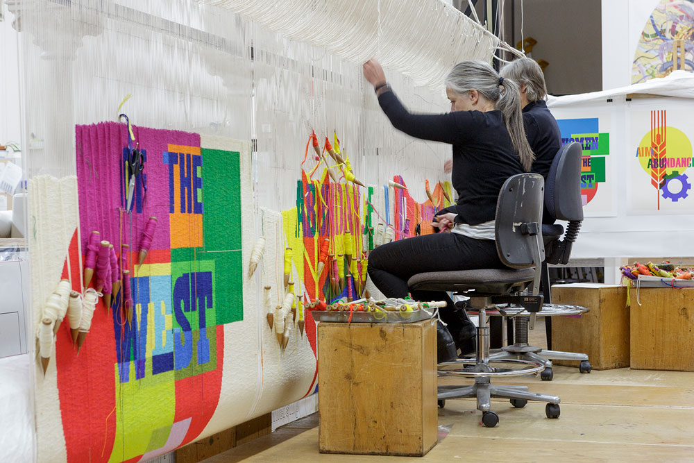 Pamela Joyce weaving on the 'The Declaration of the Rights of the Child', 2018, Emily Floyd, wool, cotton, 3 tapestries 2.0m (H) x 1.3m (W) each. Courtesy of the artist and Anna Schwartz Gallery. Photo: Jeremy Weihrauch.