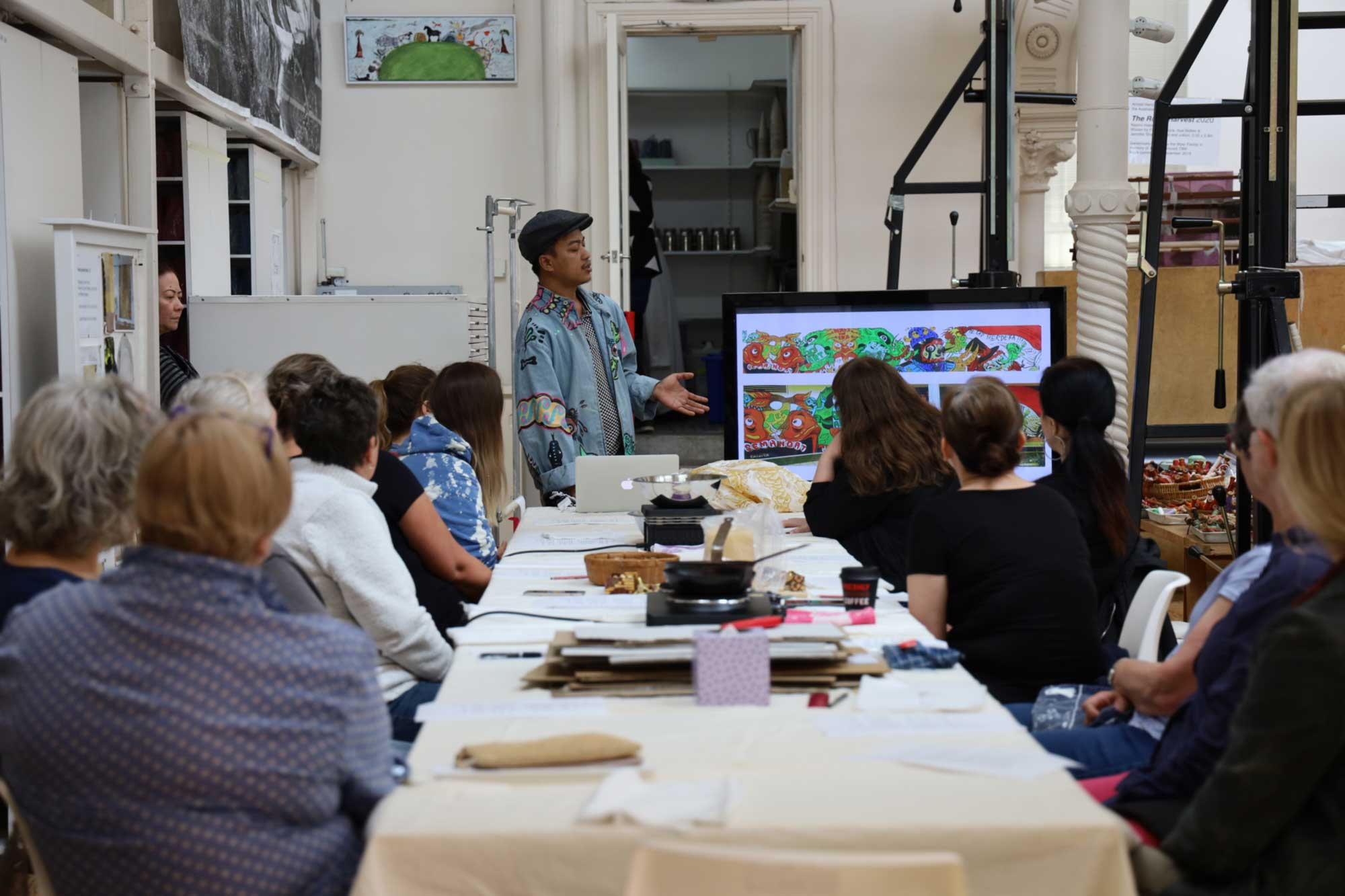 Dias Prabu speaking about his artistic practice to Tulis Batik workshop participants at the ATW. Photo: Dewie Bukit.