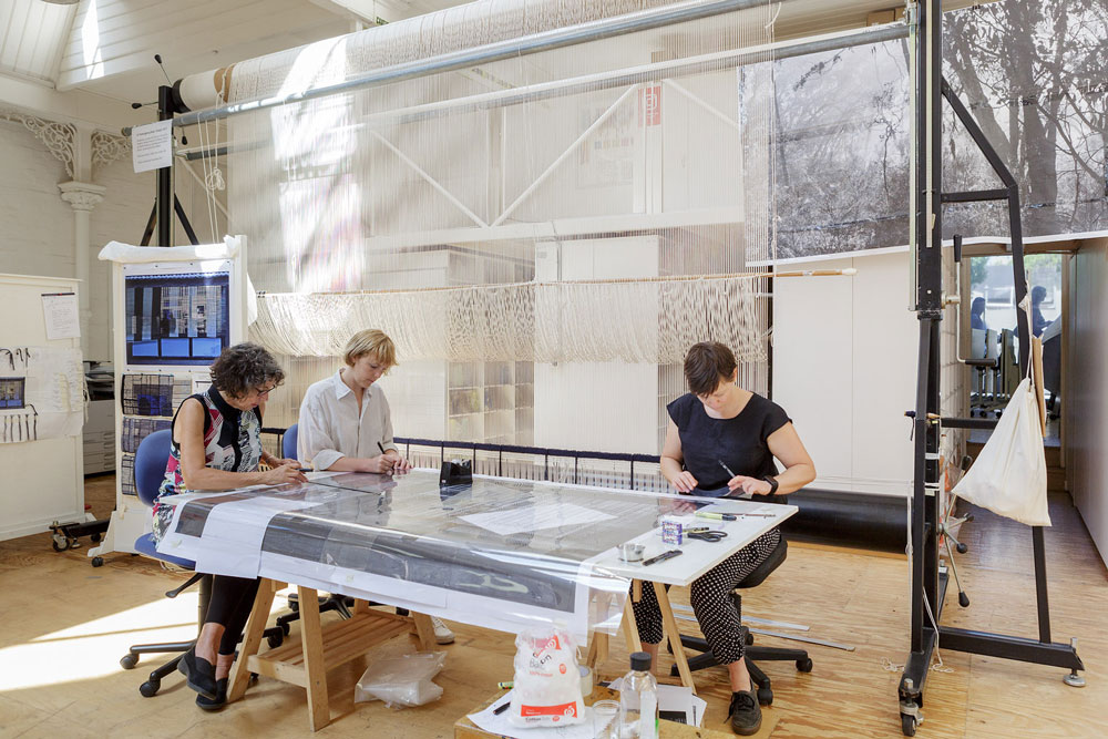Sue Batten, Sophie Morris and Karlie Hawking preparing the cartoon for '22 Temenggong Road, Twilight.'