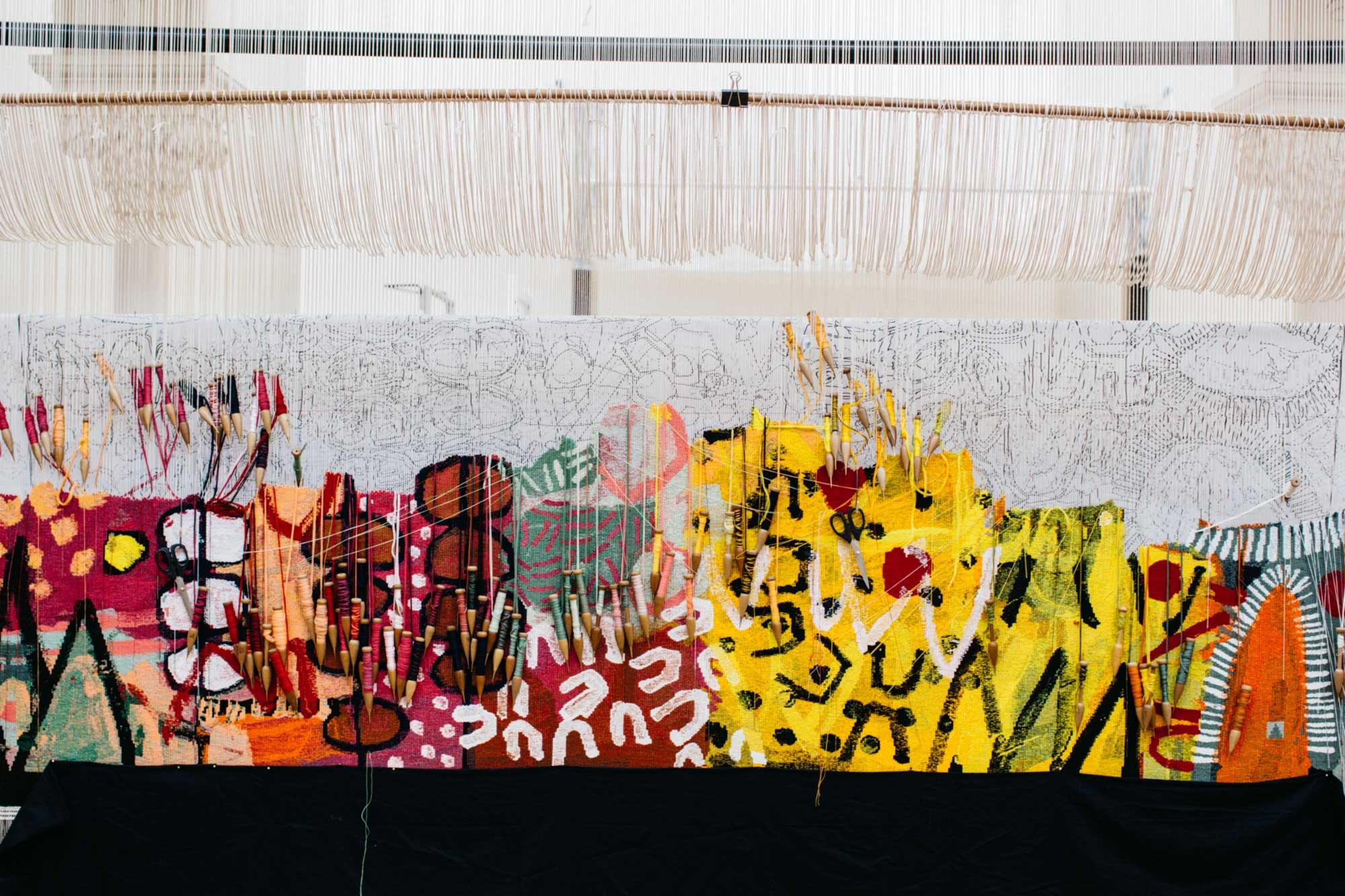 On the loom: 'The Royal Harvest' tapestry in progress, designed by Naomi Hobson and woven by Pamela Joyce, Sue Batten, Tim Gresham & Jennifer Sharpe. Photo: Marie-Luise Skibbe.