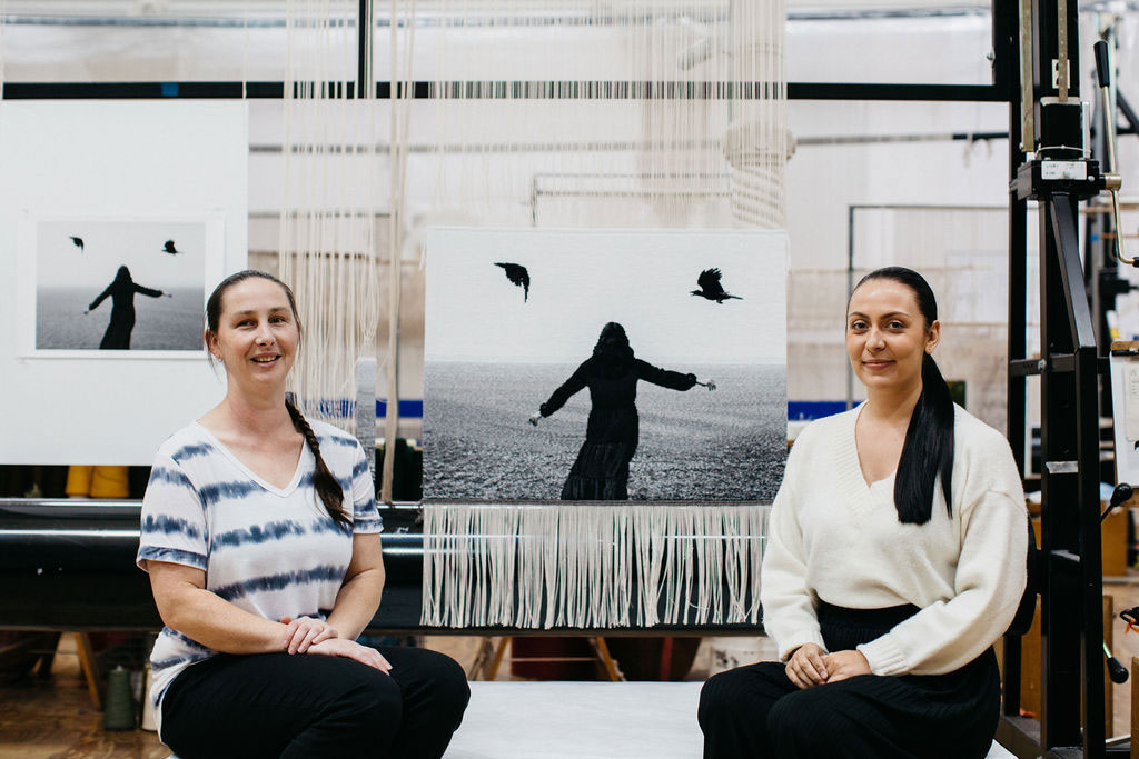 Hayley Millar Baker and Amy Cornall in front of the 'I screamed aloud (I Will Survive)' tapestry at the ATW. Photograph courtesy of Marie-Luise Skibbe.