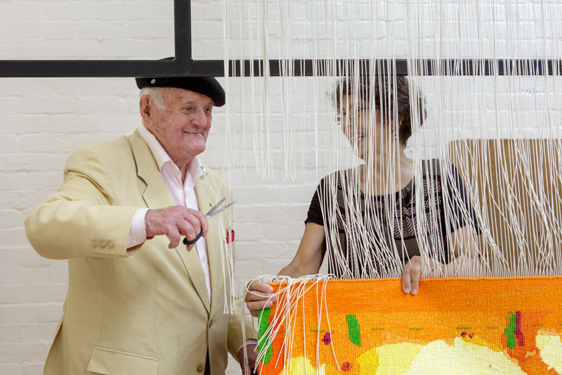 Cutting Off Ceremony for 'Sun over the You Beaut Country,' 2014, designed by John Olsen AO OBE, woven by Sue Batten, Chris Cochius, Pamela Joyce, Milena Paplinska & Cheryl Thornton. Photograph: Jeremy Weihrauch.