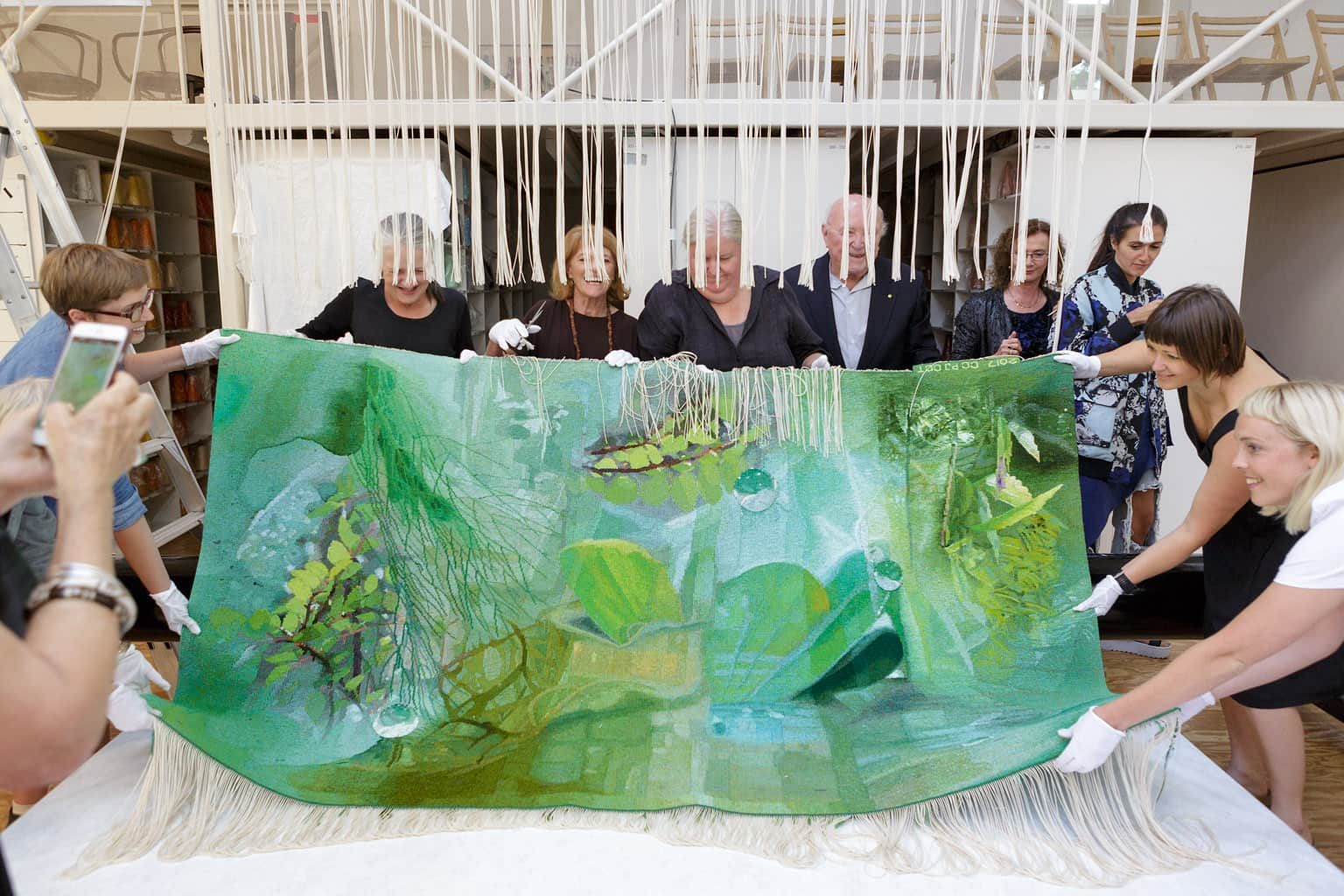 Cutting Off Ceremony for 'Listen, to the Sound of Plants' 2017, designed by Janet Laurence and woven by Chris Cochius, Pamela Joyce & Cheryl Thornton, wool and cotton, 1.2 x 2.4m. Image: Jeremy Weihrauch