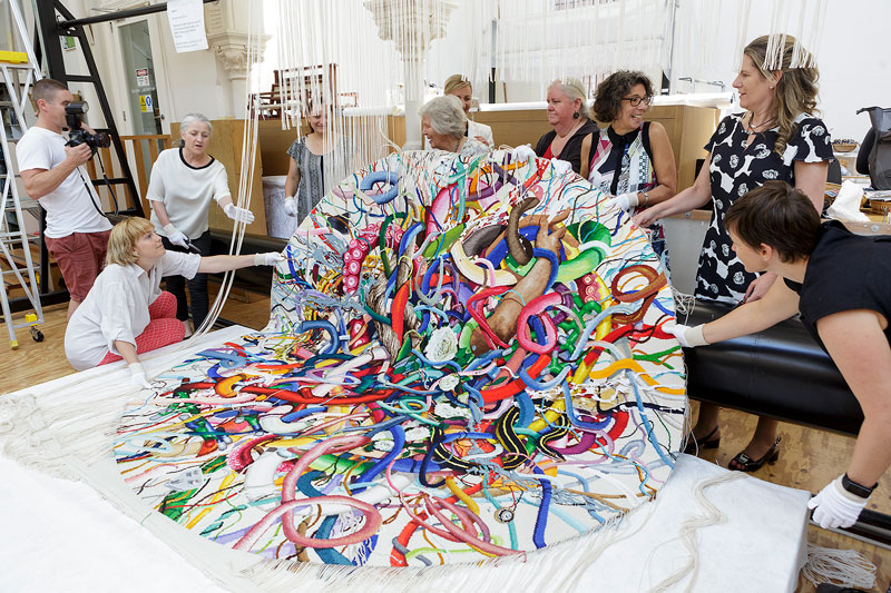 Cutting Off Ceremony for 'Gordian Knot' 2016, designed by Keith Tyson and woven by Chris Cochius, Sue Batten, Pamela Joyce & Milena Paplinska, wool and cotton, 2.4 x 2.4m. Photograph: Jeremy Weihrauch.