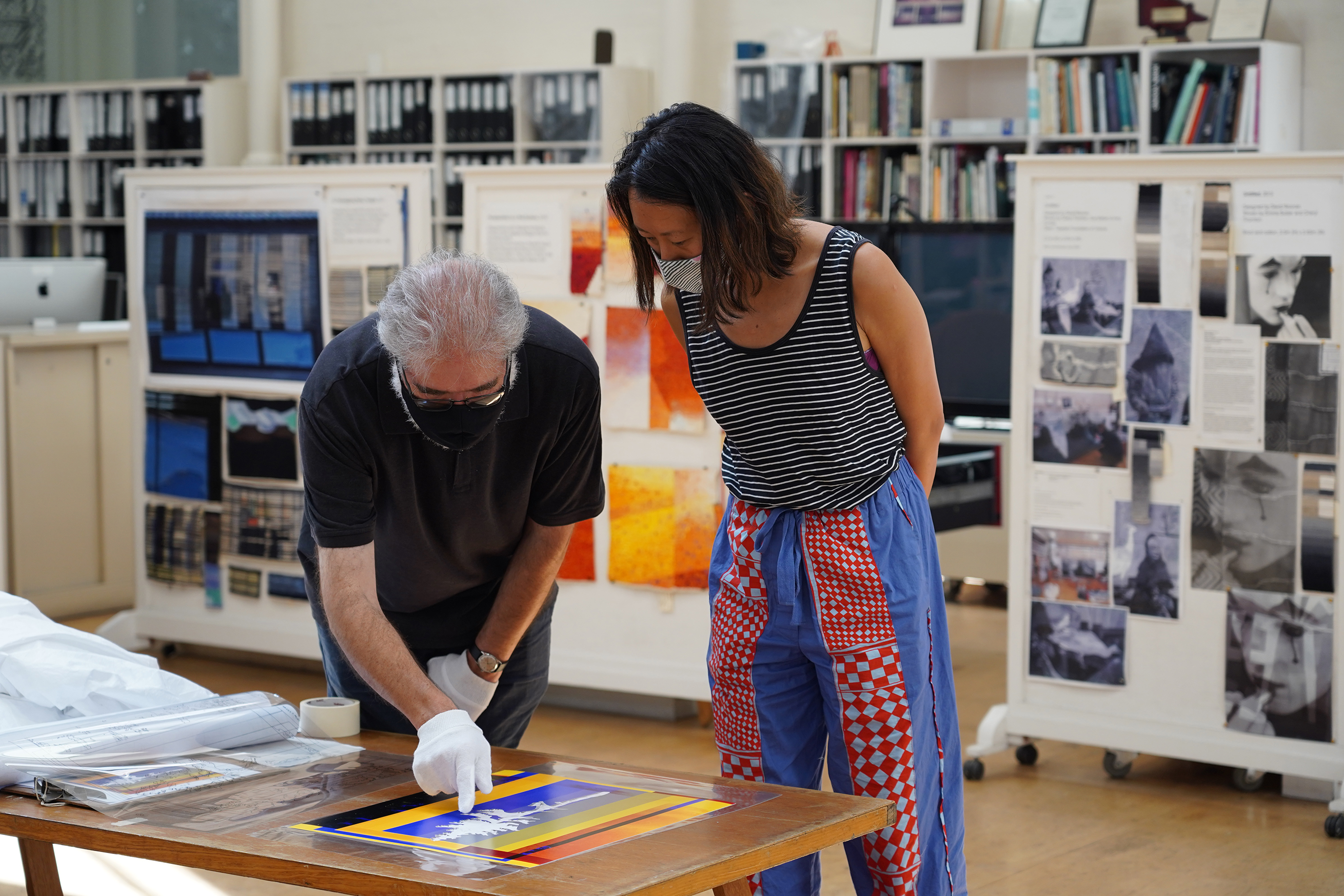 ATW weaver Tim Gresham & artist Eugenia Lim discussing the 'Future Fossils (Old Tjikko)' tapestry design at the ATW, 2021. Image: ATW.